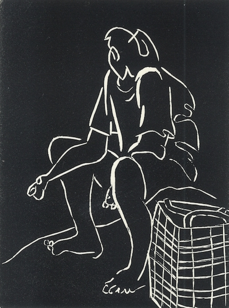5. Seated woman with plaid bag